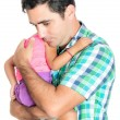 Tired and worried hispanic father carrying his small daughter — Stock Photo