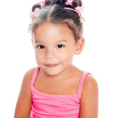 Multiracial small girl smiling sitting on the floor — Stock Photo