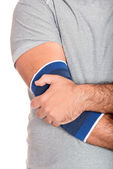 Man with a therapeutic elastic band on his elbow — Stock Photo