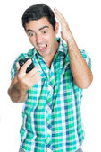 Agitated man yelling at his mobile phone — Stock Photo