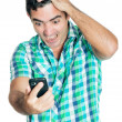 Desperate angry man looking at his mobile phone — Stock Photo