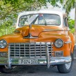 Постер, плакат: Beautifully restored old classic Dodge car in Havana