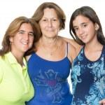 Three generations of hispanic women isolated on white — Stock Photo #48890267