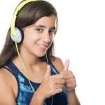 Beautiful hispanic teenager listening to music — Stock Photo #48892949