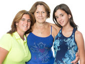 Three generations of hispanic women isolated on white — Foto de Stock