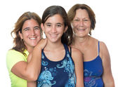 Hispanic girl with her mother and grandmother hugging and smiling — Foto de Stock
