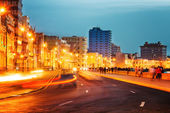 Sunset in Old Havana with  the street lights of El Malecon — Stock Photo