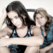 Sad teenage girl and her worried mother — Stock Photo #51175415