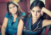 Defiant teenage girl and her worried mother — Stock Photo