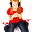 Young beautiful happy girl listening music in headphones — Stock Photo