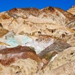 Variegated slopes of Artists Palette in Death Valley, California. Various mineral pigments have colored volcanic deposits found here. — Stock Photo #17634545
