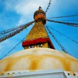 Top of the Buddhist Stupa with buddha eyes and prayer colorful flags, Kathmandu, Nepal — Stock Photo