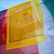 Stock Photo: Prayer flags fluttering from largest stupin Nepal, which sits amid significant Buddhist population