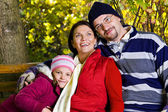 Family outdoors in autumn — Stock Photo