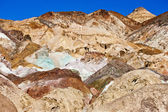The variegated slopes of Artists Palette in Death Valley, California. Various mineral pigments have colored the volcanic deposits found here. — Stock Photo