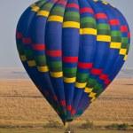 Hot air balloon over the Masai Mara National Reserve, Kenya, Africa — Stock Photo #17641677
