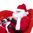 Christmas Santa Claus with a glass of red wine, isolated on white. — Stock Photo