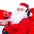 Stock Photo: Christmas SantClaus chilling out with glass of red wine, isolated on white.