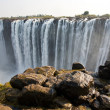 Постер, плакат: The Victoria Falls at the border of Zimbabwe and Zambia