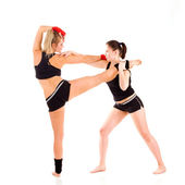 Young attractive Caucasian fitness women stretching — Stock Photo