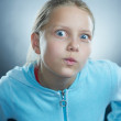 Atrractive girl making faces - Stock Photo