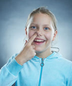 Little girl with silly face. — Stock Photo