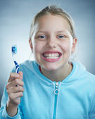 Little girl with toothbrush — Stock Photo