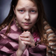 Praying little girl - Stock Photo