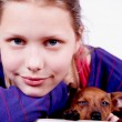 Teen girl with dog in her hands, closeup — Stock Photo