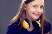 Portrait of a smiling teen girl with headphones — Stock Photo