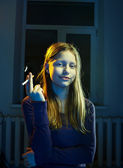 Teenager girl with a cigarette — Stok fotoğraf