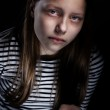 Dark portrait of a drug addicted teenager girl with pills — Stock Photo #37799023
