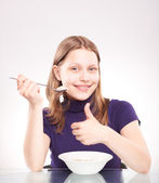 Portrait of a teen girl with spoon — Stock Photo