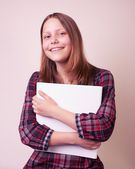 Portrait of a school girl with folder — Stock Photo