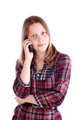Happy teen girl talking on mobile phone — Stock Photo