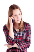 Angry teen girl talking on the mobile phone — Stock Photo