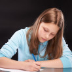 Teen girl writing — Stock Photo #48327823