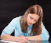 10 代の少女の書き込み — ストック写真