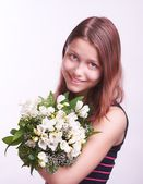 Teen girl with a bouquet of flowers — Stock Photo