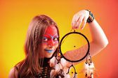 Beautiful indian teen girl with make-up holds dreamcatcher  — Zdjęcie stockowe