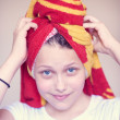 Beautiful happy teen girl with towel on her head — Stock Photo #51112413