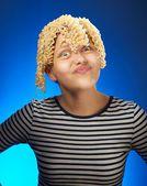 Funny teen girl with macaroni instead hair — Stock Photo