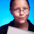 Young businesswoman in eyeglasses holds folder and smiling — Stock Photo #51345531