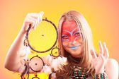 Beautiful indian teen girl with make-up holds dreamcatcher  — Stock Photo