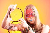 Beautiful indian teen girl with make-up holds dreamcatcher  — Stockfoto