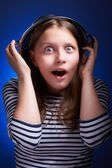 Surprised girl with a colander on her head — Stock Photo