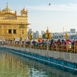 AMRITSAR, INDIA - DECEMBER 17: Sikh pilgrims in the Golden Templ - 