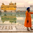 AMRITSAR, INDIA - DECEMBER 17: Sikh pilgrims in the Golden Templ - Stock Photo