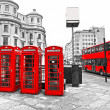 Stock Photo: LONDON - MARCH 17: Double-decker bus, red telephone boxes and un