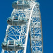 LONDON - MARCH 19 : The London Eye, erected in 1999, is a giant — Stock Photo #12237980